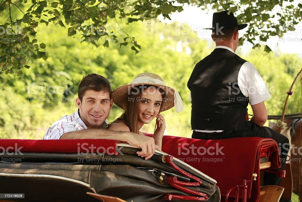 Young couple on a carriage royalty-free stock photo