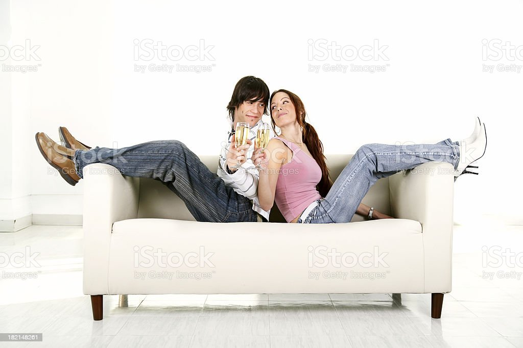 Young couple on a couch royalty-free stock photo