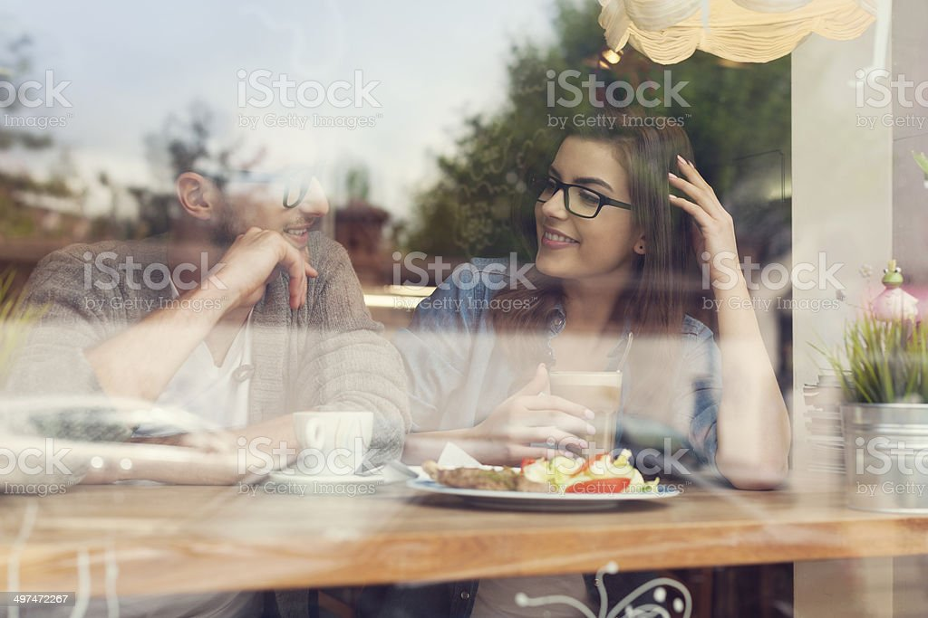 Young couple on a date at restaurant stock photo
