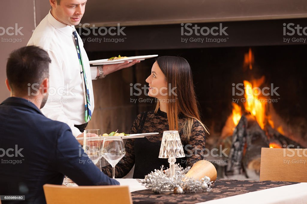 Young Couple on a Date getting Served stock photo