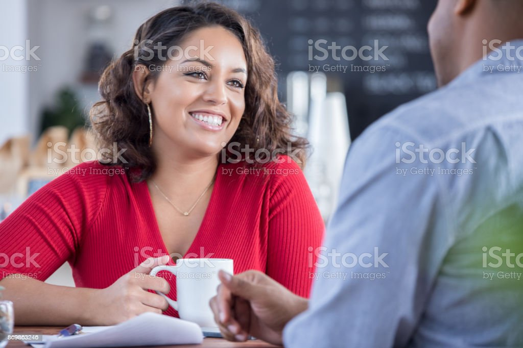 Young couple on a date in a local coffee shop stock photo