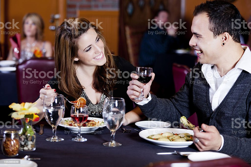 Young couple on a date in restaurant royalty-free stock photo