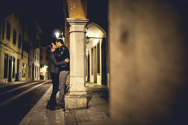 Young Couple on a Date Young couple kissing on a street real couples making love stock pictures, royalty-free photos & images