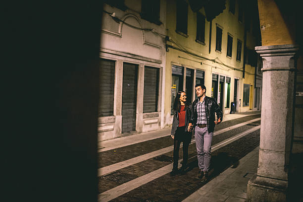 Young Couple on a Date Young couple walking down the street at night real couples making love stock pictures, royalty-free photos & images
