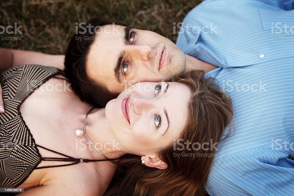Young couple on a grass stock photo