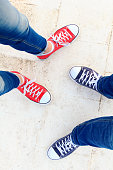 Woman and man sneakers shoes standing close feet