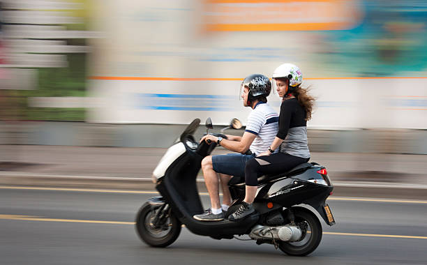Young couple  on a motorbike stock photo