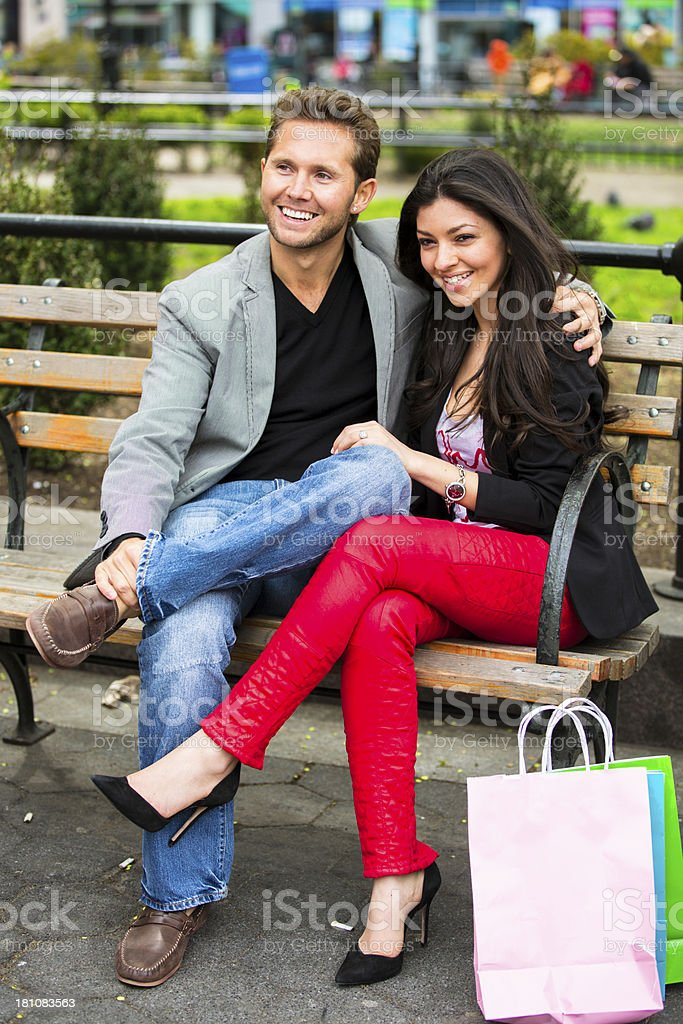 Young couple on a park bench royalty-free stock photo