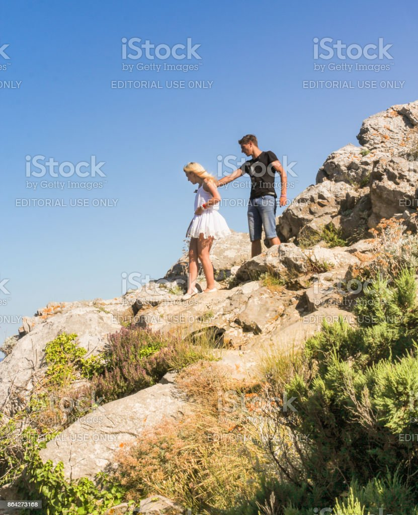 Young couple on a rock. royalty-free stock photo