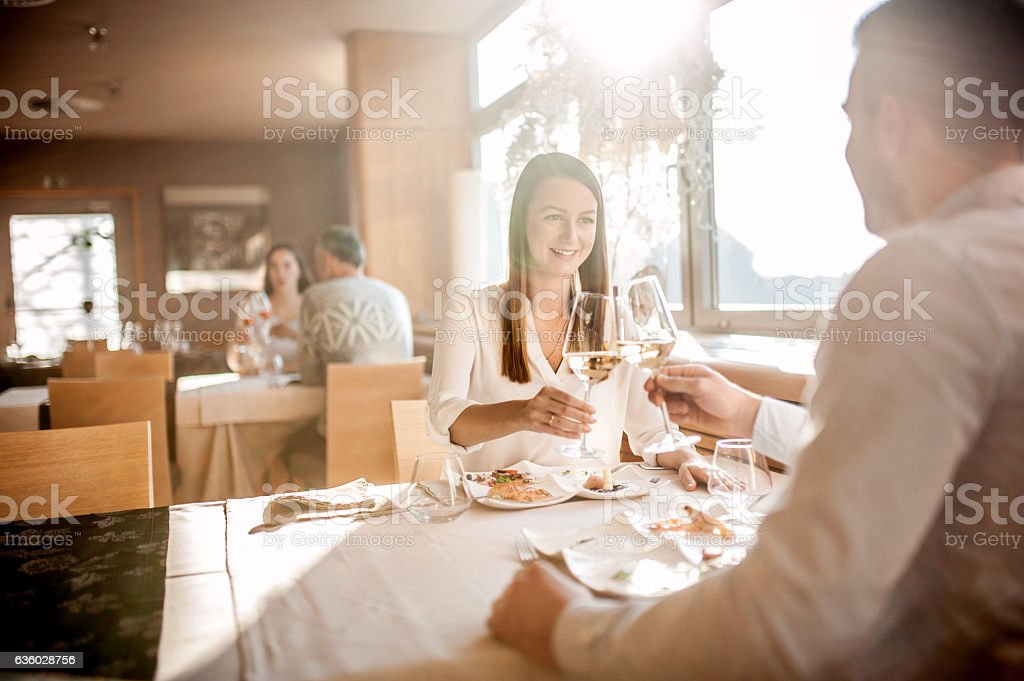 Young Couple on a Romantic Date in a Restaurant stock photo