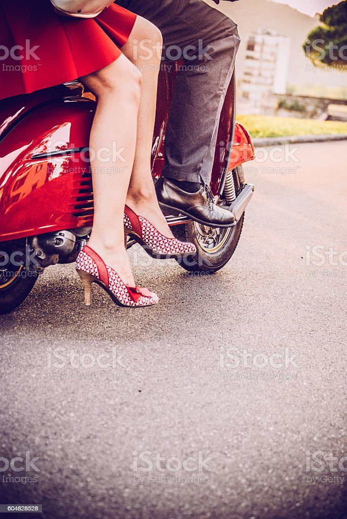 Young Couple on a Vintage Scooter stock photo