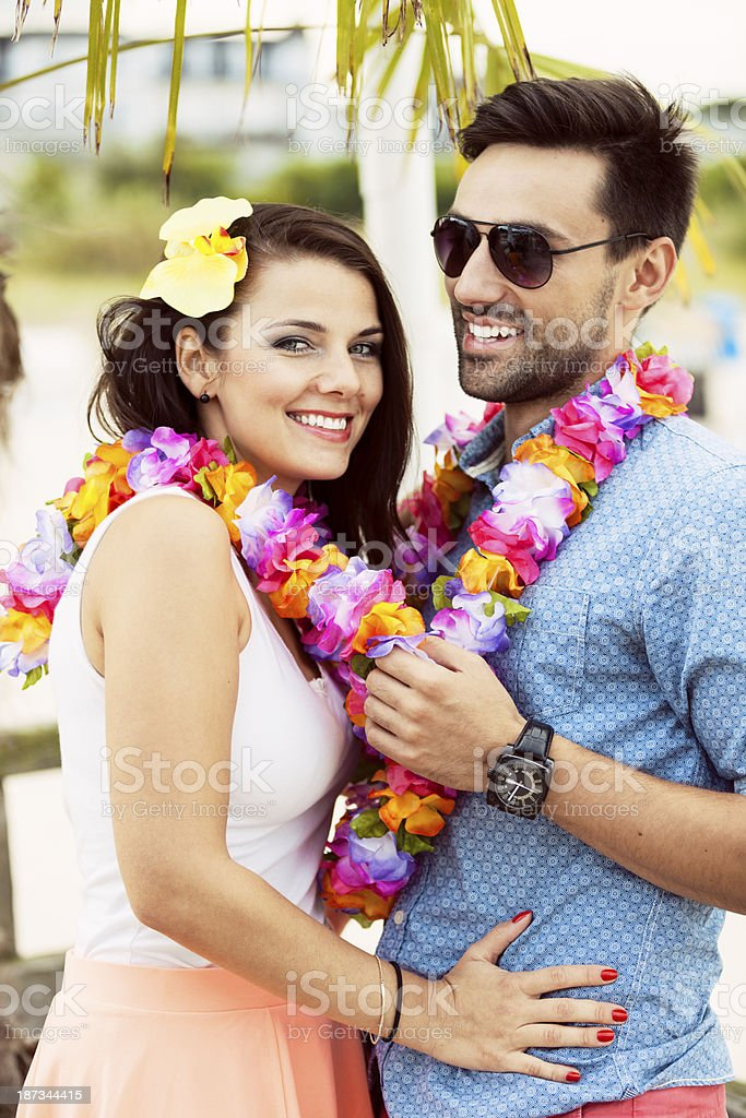 Young Couple On Beach Party royalty-free stock photo