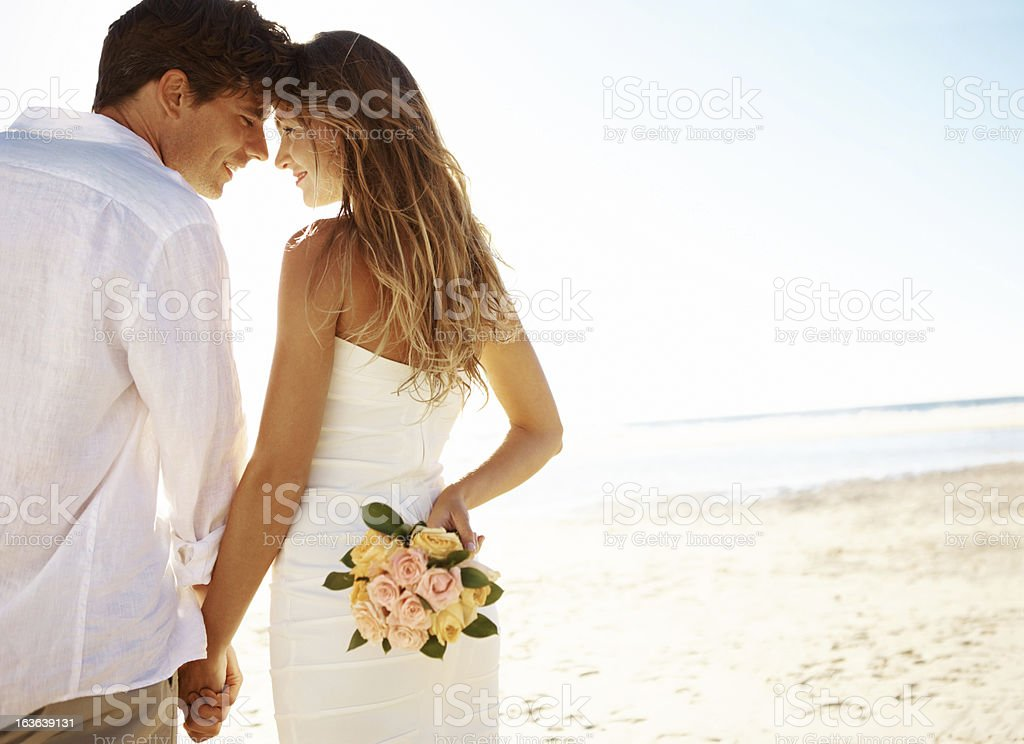 Young couple on beach royalty-free stock photo
