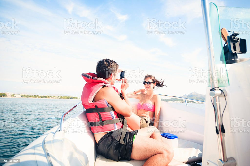 young couple on boat stock photo