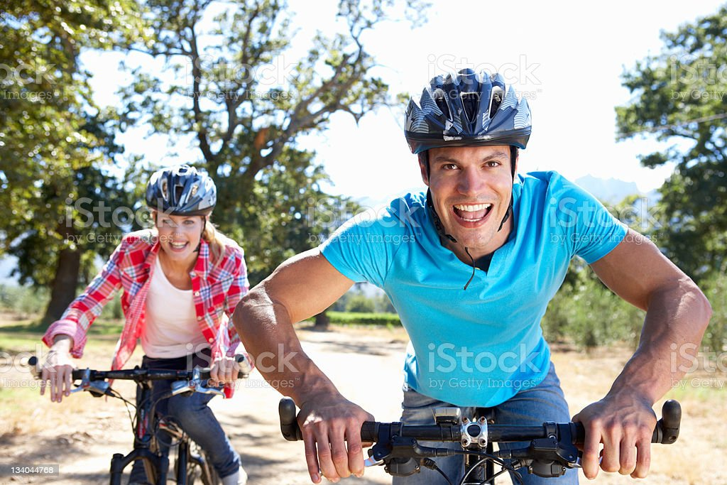 Young couple on country bike ride royalty-free stock photo