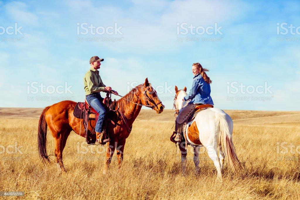 Young Couple On Horseback stock photo