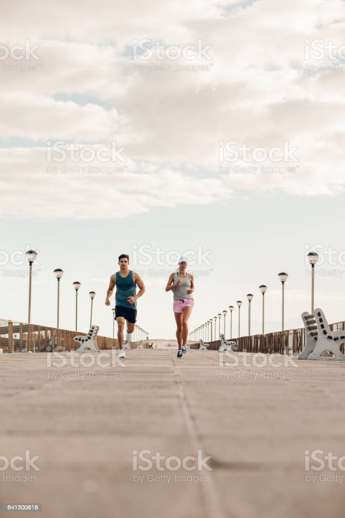 Young couple on morning run stock photo