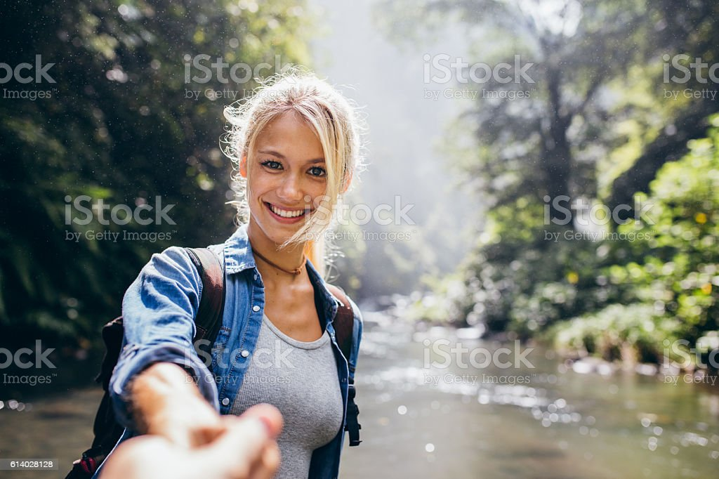 Young couple on nature hike stock photo