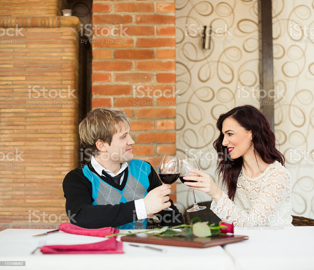 Young couple on romantic date in restaurant royalty-free stock photo