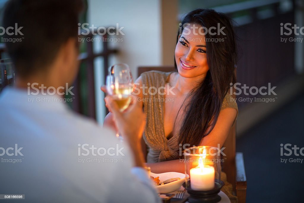 young couple on romantic dinner with candles stock photo