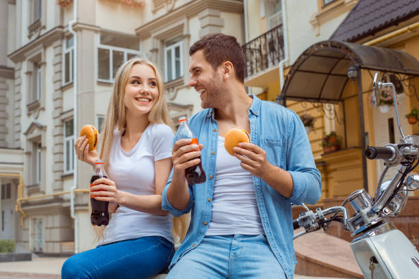 Young couple on scooter travel together transportation stock photo