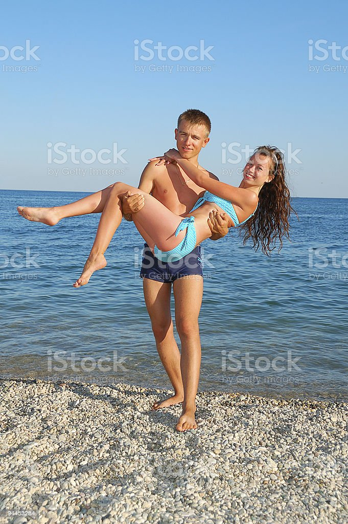 young couple on summer beach royalty-free stock photo