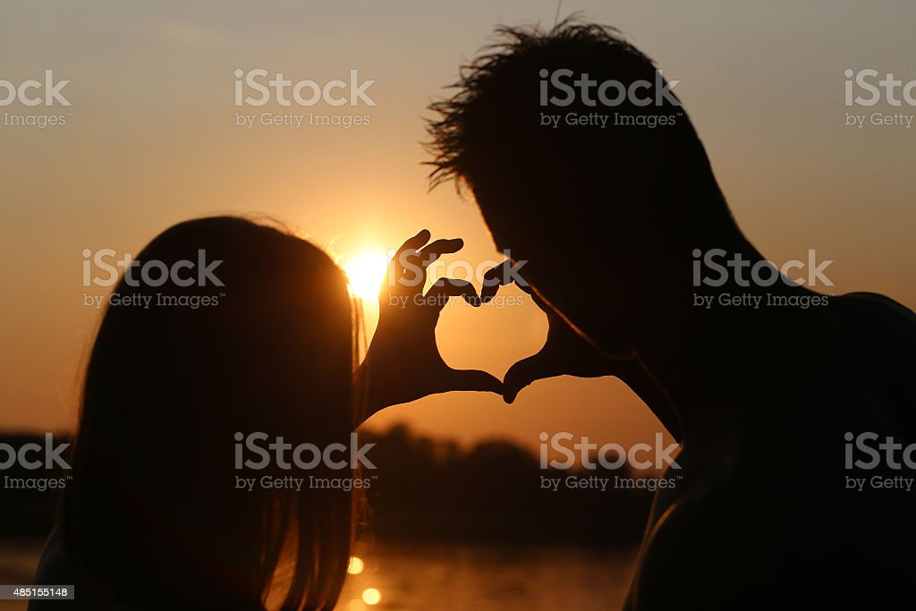 young couple on sunset stock photo