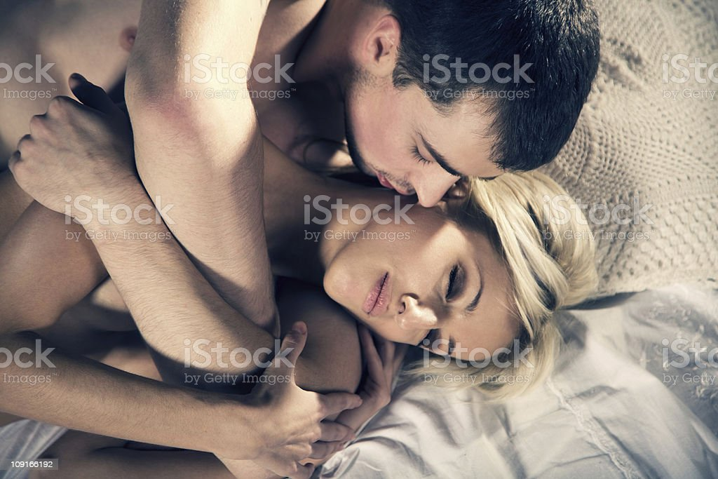 Young couple on the bed stock photo