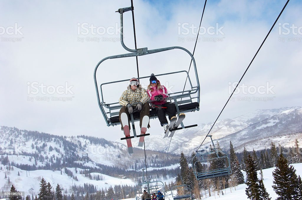 Young Couple on the Chair Lift stock photo