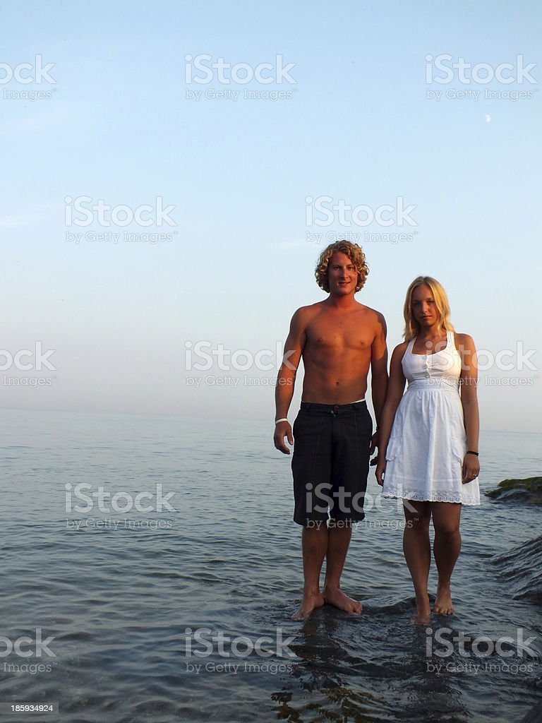 Young couple on the rocks royalty-free stock photo