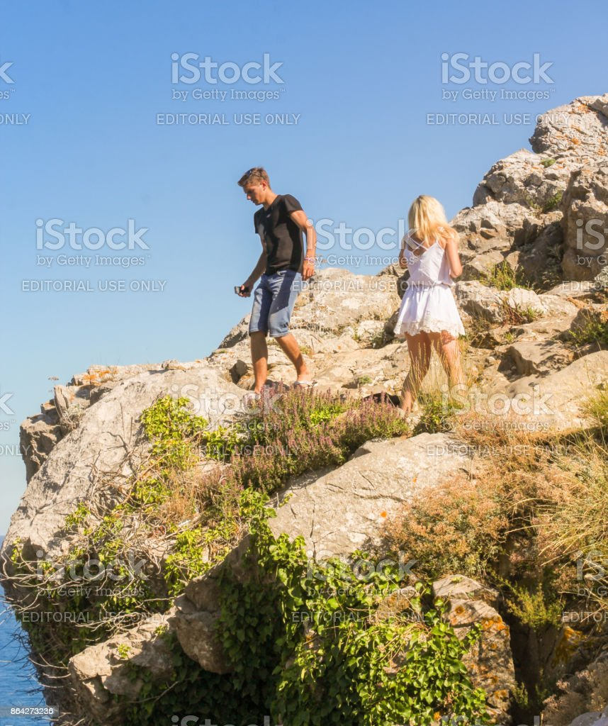 Young couple on the rocks. royalty-free stock photo