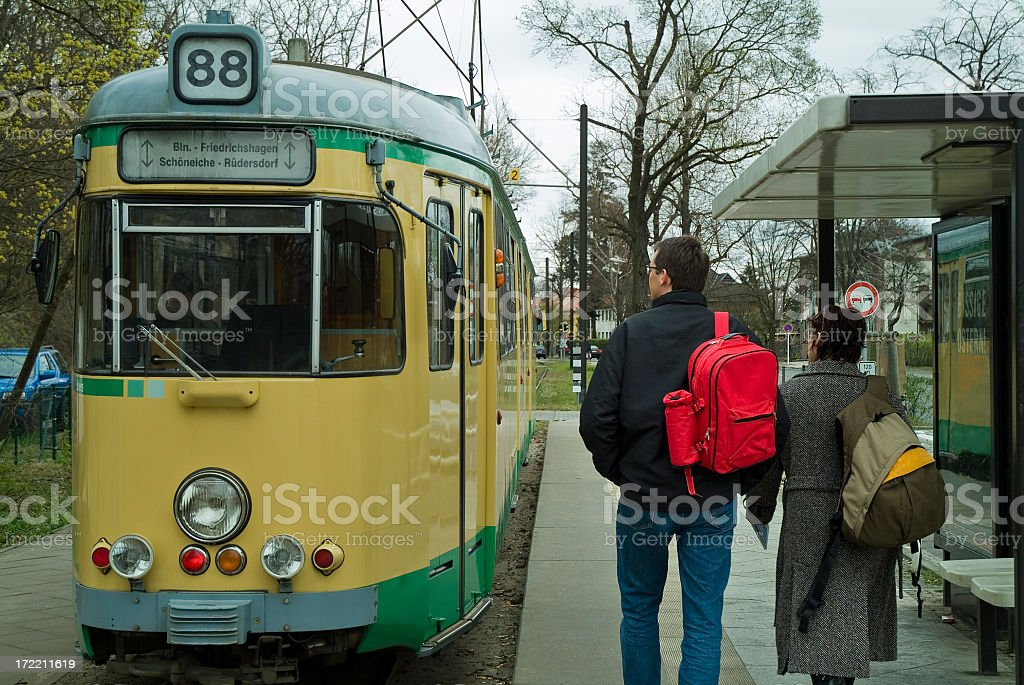 Young couple On their way to the tramway. stock photo