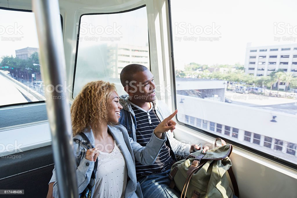 Young couple on tram stock photo