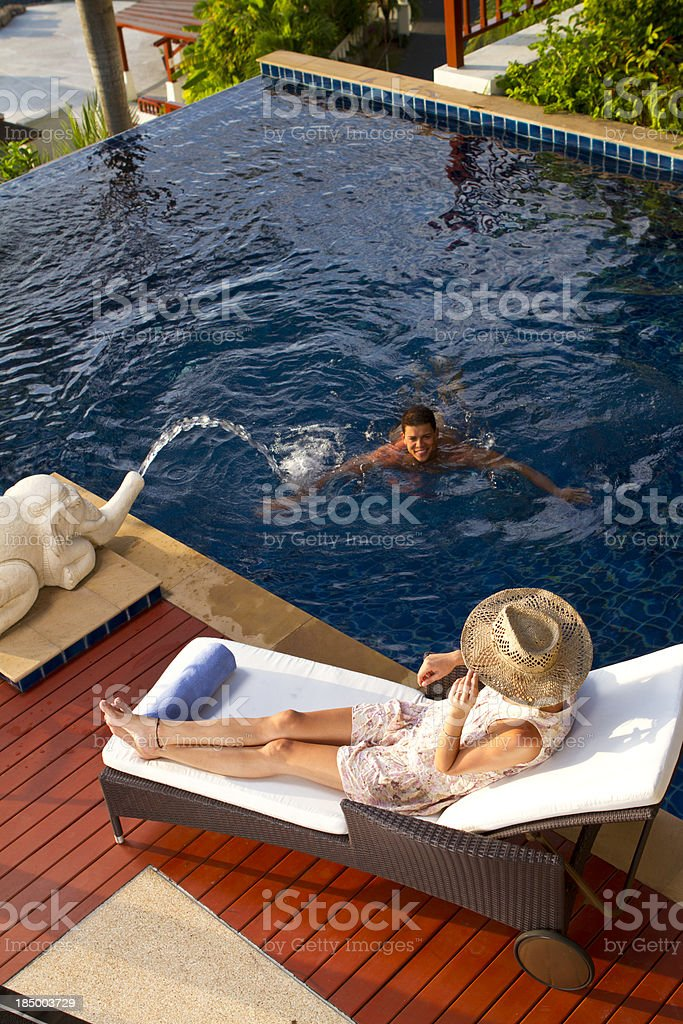 Young couple on vacation in a luxurious resort royalty-free stock photo