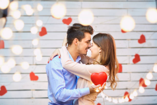 young couple on valentine's day. - attached stock pictures, royalty-free photos & images