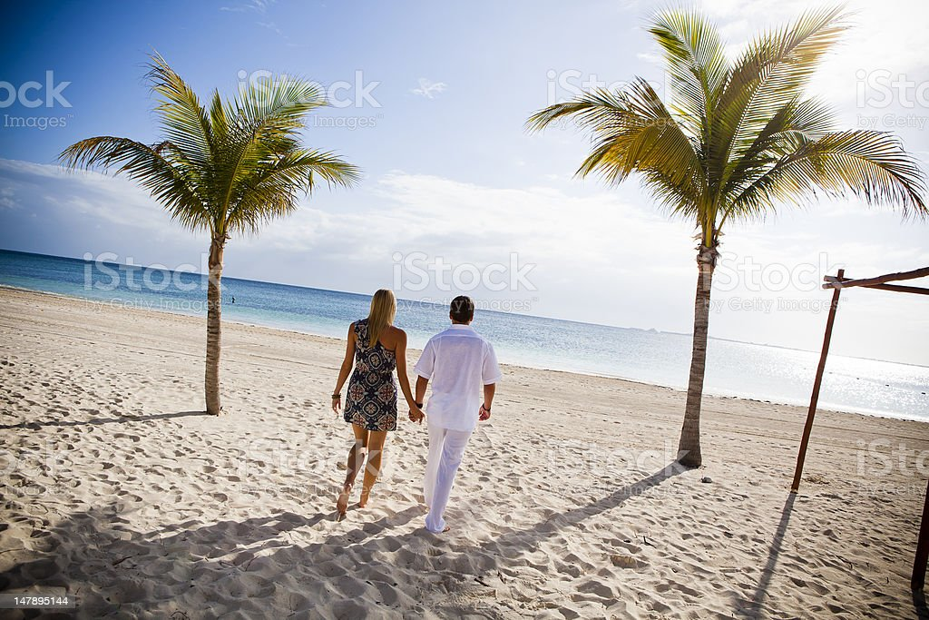 Young Couple on White Sand Beach stock photo