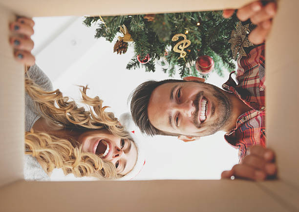 Young couple opening a christmas present stock photo