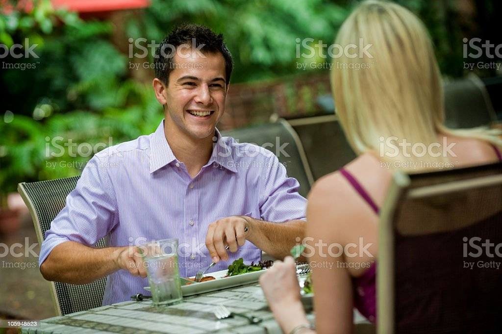 A young couple out on a dinner date royalty-free stock photo