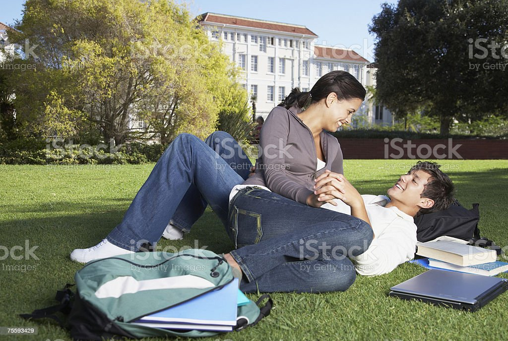 A young couple outdoors being affectionate royalty-free stock photo