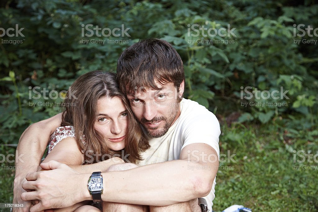 Young couple outdoors cuddling royalty-free stock photo