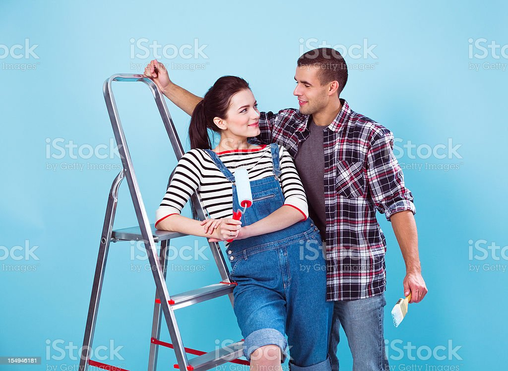Young couple painting a wall royalty-free stock photo