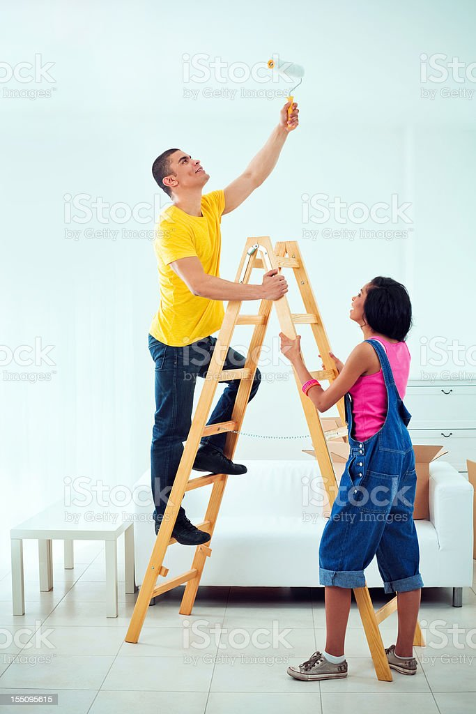 Young couple painting apartment royalty-free stock photo