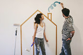 More files of this series and models on port. Young spanish couple painting their new home. made in Barcelona Spain.