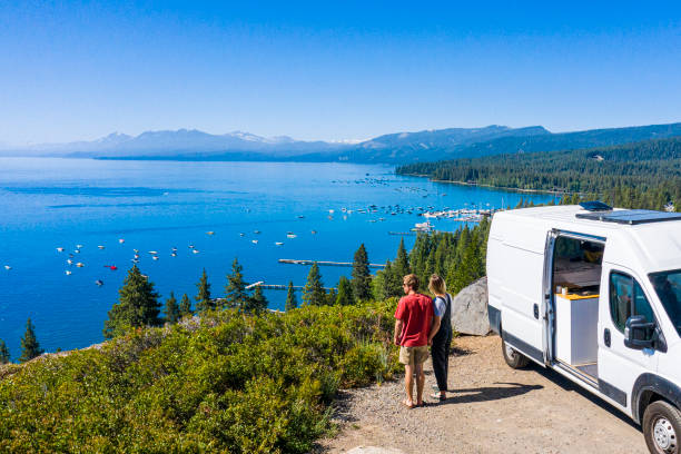 Young Couple Parked Van at a Viewpoint of Lake Tahoe stock photo
