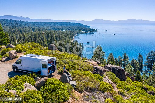 istock Young Couple Parked Van at a Viewpoint of Lake Tahoe 1253513691
