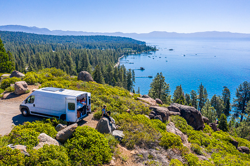 Young Couple Parked Van at a Viewpoint of Lake Tahoe