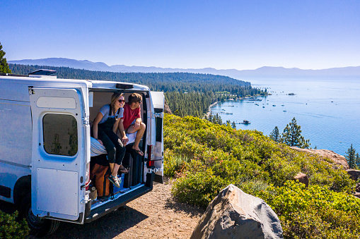 A Young Couple Parked Van at a Viewpoint of Lake Tahoe