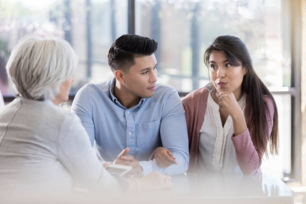 young couple participate in marriage counseling - infertility stock pictures, royalty-free photos & images