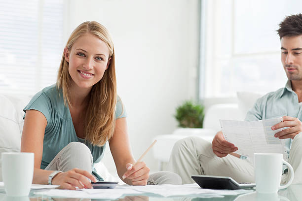 young couple paying bills. - paid stock pictures, royalty-free photos & images