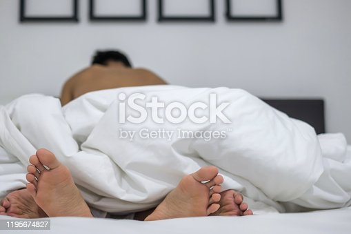 Young couple people in love lying in white bed, Having sex. Romantic and Valentine